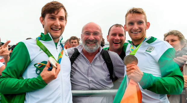 Paul (left) and Gary O'Donovan are congratulated by their father Teddy after the final. Photo: Brendan Moran