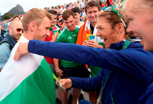 Gary O'Donovan is congratulated by Ireland team-mates Sinead Lynch and Claire Lambe, right, after finishing second in the Men's Lightweight Double Sculls. Photo: Stephen McCarthy