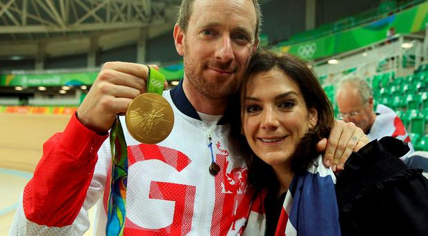Bradley Wiggins holds his gold medal at Olympics