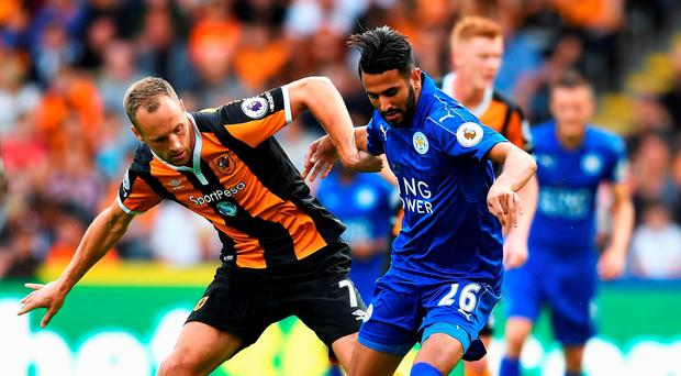 David Meyler of Hull City and Riyad Mahrez of Leicester City battle for possession during the Premier League match between Hull City and Leicester City at KCOM Stadium (Photo by Michael Regan/Getty Images)