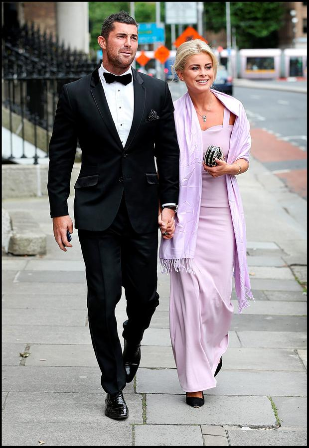Rob Kearney and Jess Redden attending Jamie Heaslip and Sheena O'Buachalla's wedding outside the Newman University Church on St Stephens Green. Pic Steve Humphreys 13th August 2016