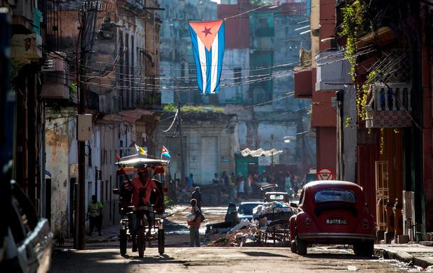 A Cuban flag hangs across a street in Havana, Cuba. Picture: AP Photo/Desmond Boylan