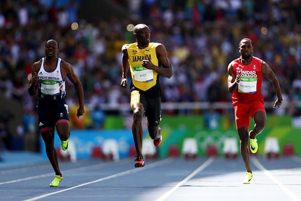 RIO DE JANEIRO, BRAZIL - AUGUST 13: Usain Bolt (C) of Jamaica, Richard Thompson of Trinidad and Tobago and James Dasaolu of Great Britain compete in the Men's 100m Round 1 on Day 8 of the Rio 2016 Olympic Games at the Olympic Stadium on August 13, 2016 in Rio de Janeiro, Brazil. (Photo by Paul Gilham/Getty Images)
