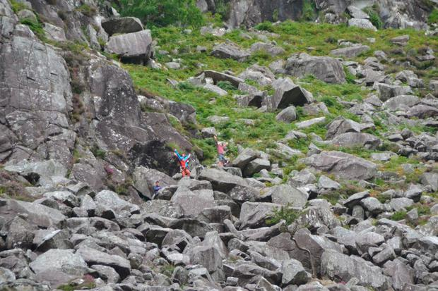 Rock climbers direct the helicopter to the injured woman in Glendalough, Co Wicklow. Picture: Philip Grant