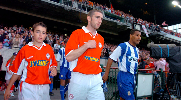 Shelbourne captain Owen Heary and Deportivo La Coruna captain Mauro Da Silva lead their teams out at Lansdowne Road in August 2004. Photo: Sportsfile