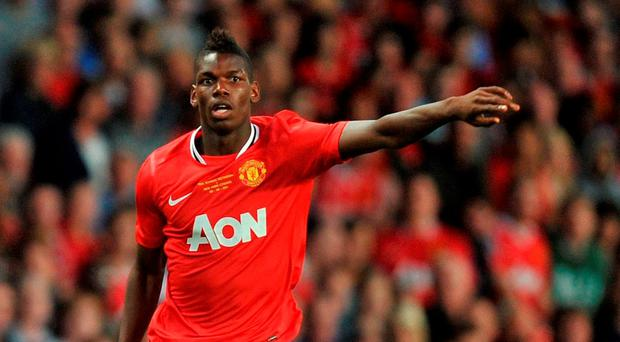 Paul Pogba's transfer from Juventus to Manchester United raised the world record to £89.3m. Photo: Martin Rickett/PA Wire