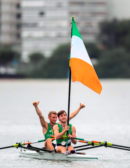 Gary (left) and Paul O'Donovan wave an improvised flagpole after their silver medal triumph in Rio. Photo: Sportsfile