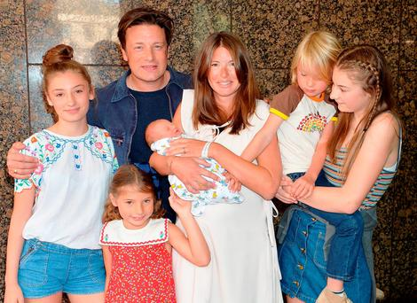 OLIVER'S ARMY: Jools and Jamie Oliver leave the Portland Hospital in London with the newest addition to the Oliver family, a baby boy, and their older children (left to right) Daisy Boo Pamela, Petal Blossom Rainbow, Buddy Bear Maurice and Poppy Honey Rose. Photo: John Stillwell/PA