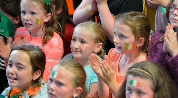 Pupils from Lisheen NS watching the O'Donovan brothers. 'The school has three classrooms and 70 pupils. And two Olympic medals.' Photo: Michael MacSweeney