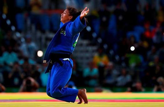 Rafaela Silva of Brazil celebrates after defeating Sumiya Dorjsuren of Mongolia in the Women's -57 kg Final - Gold Medal Contest on Day 3 of the Rio 2016 Olympic Games at Carioca Arena 2 on August 8, 2016 in Rio de Janeiro, Brazil. (Photo by David Ramos/Getty Images)
