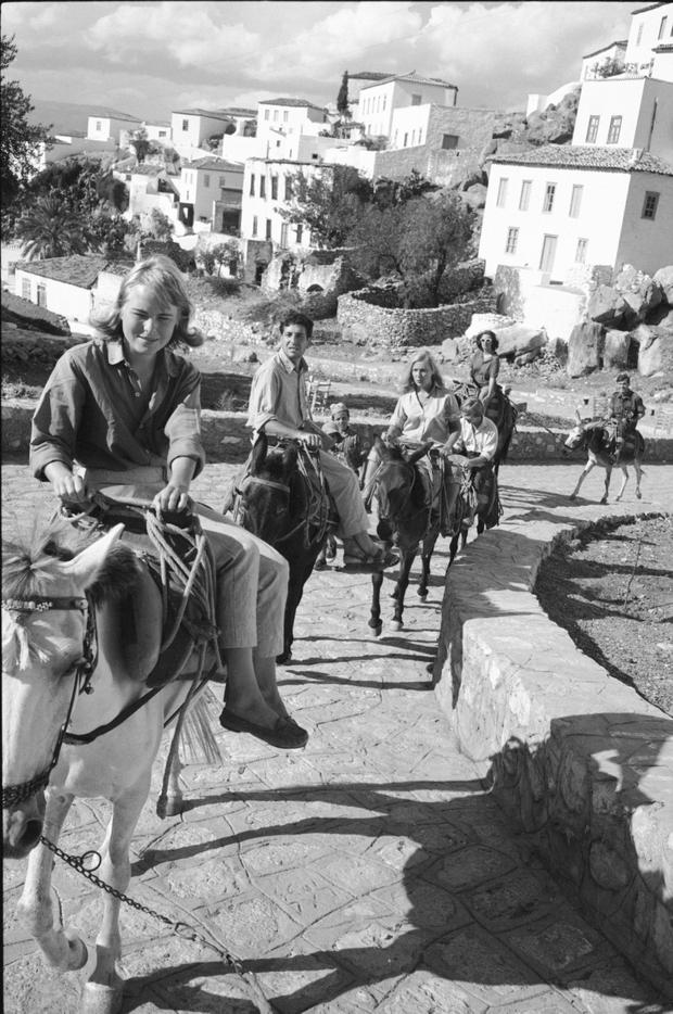 Marianne Ihlen, Cohen and friends ride mules along a stone path on Hydra, Greece, in October 1950; the Greek island was where their love affair began and blossomed. Photo by James Burke/The LIFE Picture Collection/Getty Images