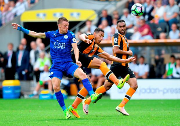 Jamie Vardy of Leicester City and Jake Livermore of Hull City battle for possession in the air. (Photo by Michael Regan/Getty Images)