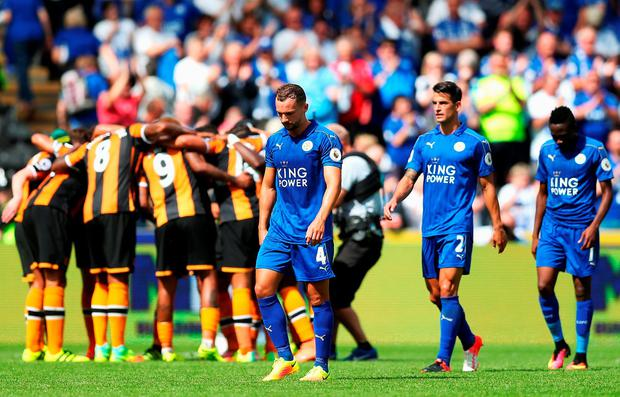 Hull City players create a huddle while Leicester City players walk off the pitch. Photo: Getty