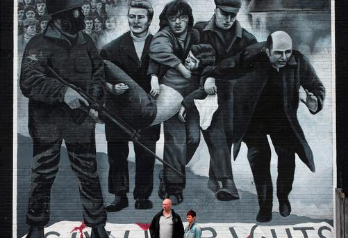 Powerful: A mural in the Bogside area of Derry depicting Dr Edward Daly on Bloody Sunday in January 1972. Photo: Brian Lawless/PA Wire