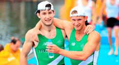 Ireland's Gary O'Donovan (right) and Paul O'Donovan (left) celebrate winning silver in the Lightweight Men's Double Sculls Final at The Lagoa Stadium on the seventh day of the Rio Olympic Games, Brazil. Photo credit: Mike Egerton/PA Wire