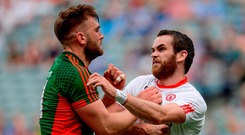 Mayo's Aidan O'Shea fends off Tyrone's Ronan McNamee. Photo: Sportsfile
