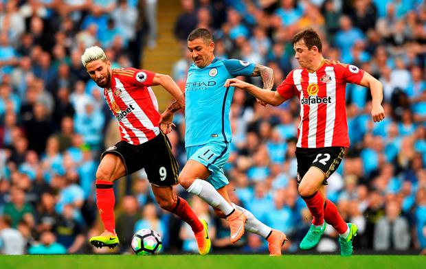 MANCHESTER, ENGLAND - AUGUST 13: Aleksander Kolorov of Manchester City battle for possession with Fabio Borini of Sunderland and Donald Love of Sunderland during the Premier League match between Manchester City and Sunderland at Etihad Stadium on August 13, 2016 in Manchester, England. (Photo by Stu Forster/Getty Images)