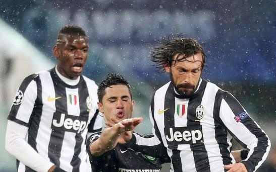 Andrea Pirlo played alongside Paul Pogba at Juventus for three years CREDIT: REUTERS
