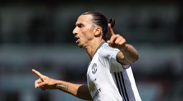 MANCHESTER, ENGLAND - AUGUST 13: Zlatan Ibrahimovic of Manchester United celebrates after scoring a goal to make it 0-3 during the Premier League match between Manchester City and Sunderland at Etihad Stadium on August 13, 2016 in Manchester, England. (Photo by Matthew Ashton - AMA/Getty Images)