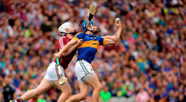 John McGrath of Tipperary in action against John Hanbury of Galway during the GAA Hurling All-Ireland Senior Championship Semi-Final game between Galway and Tipperary at Croke Park, Dublin. Photo by Piaras Ó Mídheach/Sportsfile