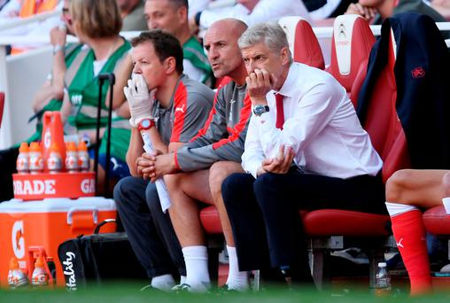 Arsenal manager Arsene Wenger looks dejected