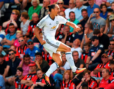 Zlatan Ibrahimovic leaps with delight after scoring on his league debut. Photo: Stu Forster/Getty Images