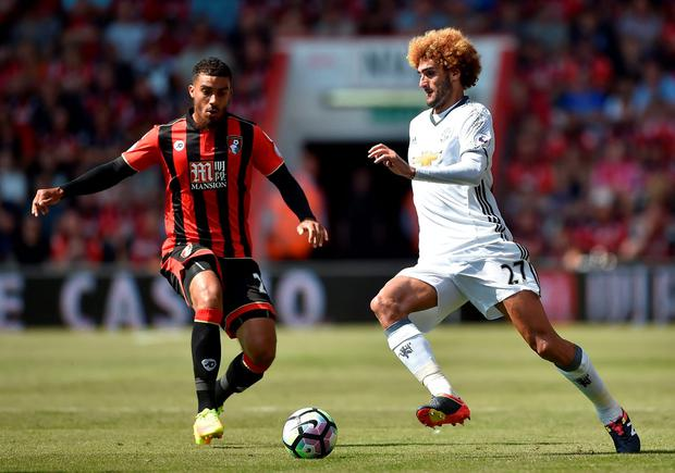 Manchester United's Marouane Fellaini in action with Bournemouth's Lewis Grabban. Photo: Hannah McKay/Reuters