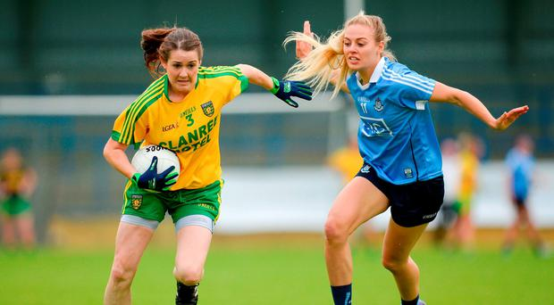 Katy Herron of Donegal in action against Nicole Owens of Dublin. Photo: Sportsfile
