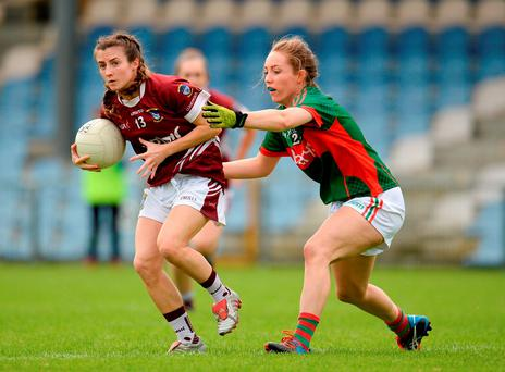 Ciara Blundell of Westmeath in action against Leona Ryder of Mayo. Photo: Sportsfile