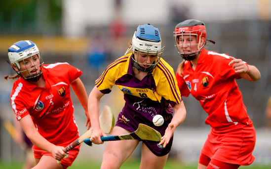 Úna Sinnott of Wexford in action against Meabh Cahalane, left, and Leanne O'Sullivan of Cork. Photo: Sportsfile