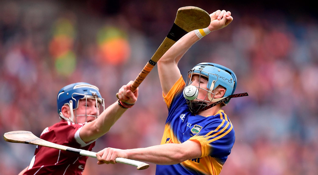 Cianan Fahy of Galway knocks the ball away from Tipperary's Jake Morris. Photo: Sportsfile