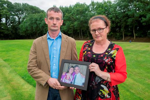 Kevin and Margo Greaney with a photo of their late brother Michael and his wife Valerie. Photo: Michael MacSweeney/Provision