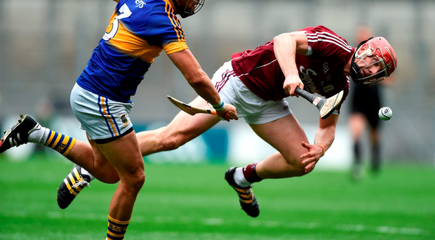 Joe Canning falls to the ground with a hamstring injury that forced him off the field. Photo: Sportsfile