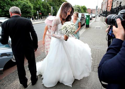 Sheena O'Buachalla arrives for her wedding to Jamie Heaslip at Newman University Church on St Stephen's Green. Photo: Steve Humphreys