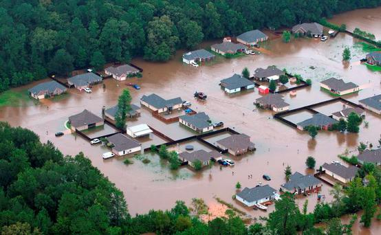 Flooded homes along the Tangipahoa River near Amite, Louisiana. Photo: Ted JacksonNOLA.com The Times-Picayune via AP