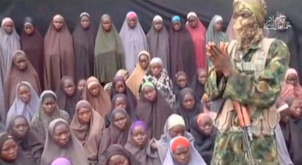 A still from Boko Haram video, showing a masked man talking to the kidnapped schoolgirls. Image: Reuters
