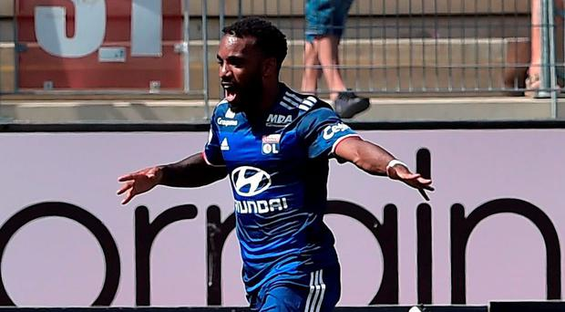Alexandre Lacazette celebrates while scoring a hat-trick for Lyon yesterday. Photo: Patrick Hertzog/AFP/Getty Images