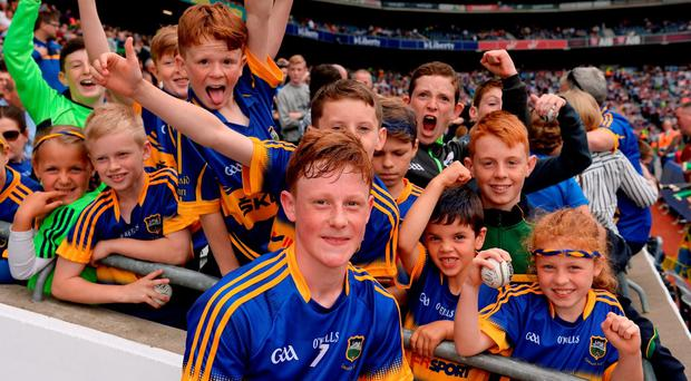 Jerome Cahill of Tipperary poses with young supporters after the minor match in Croke Park. Photo: Piaras Ó Mídheach/Sportsfile
