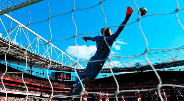 Petr Cech flies through the air but can't prevent Philippe Coutinho equalising for Liverpool against Arsenal at the Emirates. Photo: Mike Hewitt/Getty Images