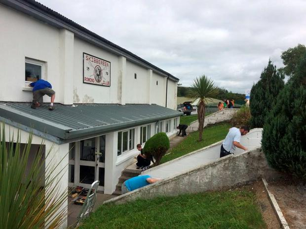 Volunteers hard at work repainting Skibbereen Rowing Club in anticipation of the homecoming party for Rio silver medal winners Gary and Paul O'Donovan
