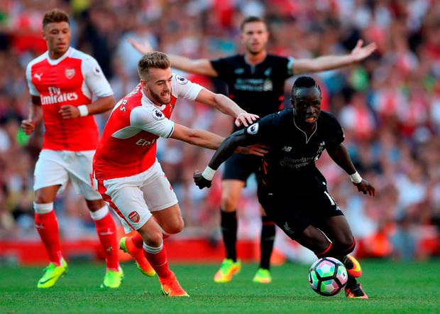 Arsenal's Calum Chambers (left) and Liverpool's Sadio Mane battle for the ball. Photo: Nick Potts/PA Wire.