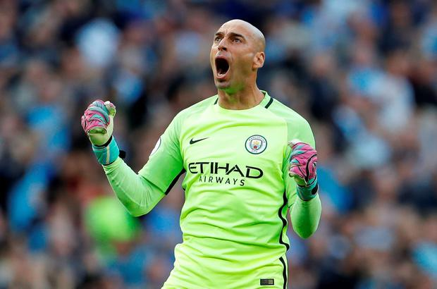 Manchester City's Willy Caballero celebrates Sunderland's Paddy McNair scoring an own goal. Photo: Reuters