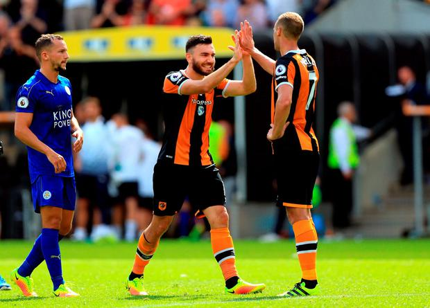 Hull City's Robert Snodgrass (left) and David Meyler celebrate after the game. Photo: Nigel French/PA Wire.