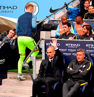 Pep Guardiola acknowledges the crowd as Joe Hart takes his seat on the bench for Saturday's game against Sunderland. Photo: Anthony Devlin/PA Wire