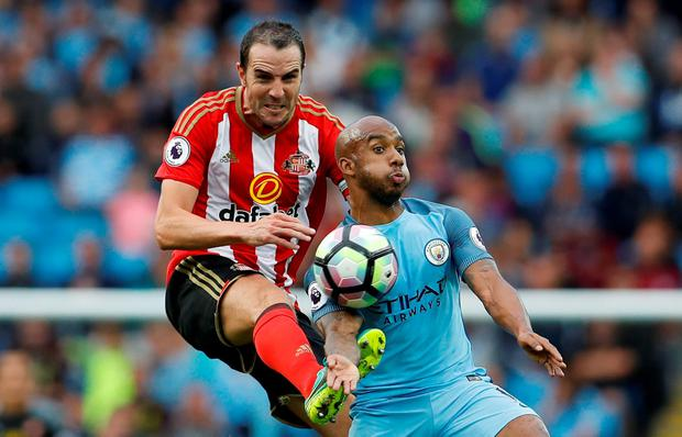 Sunderland's John O'Shea in action with Manchester City's Fabian Delph. Photo: Lee Smith/Action Images via Reuters