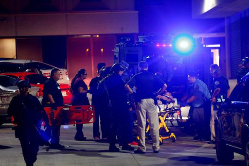 A man shot during disturbances following a police shooting is taken into a hospital in Milwaukee, Wisconsin, U.S. August 14, 2016