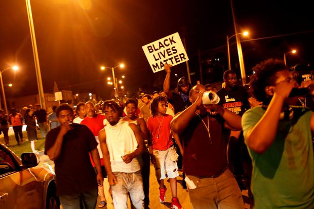 Protestors march during disturbances following the police shooting of a man in Milwaukee, Wisconsin, U.S. August 14, 2016