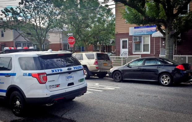 A police vehicle is parked across the street from the Al-Furqan Jame Masjid mosque, Sunday, Aug. 14, 2016, in the Ozone Park section of the Queens borough of New York. The leader of the mosque, Imam Maulama Akonjee, 55, and an associate, Tharam Uddin, 64, were fatally shot as they left afternoon prayers Saturday