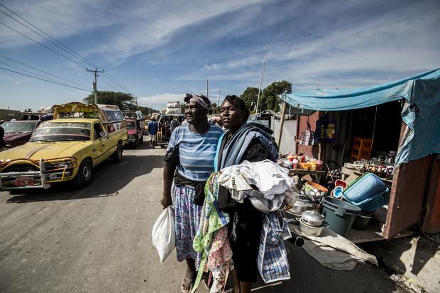 Fleurant Annette at the market in Gonaives where she sells garments she has made or fixed. She is a mobile seller, strategically moving around making sales. Photo: Jennifer Barker