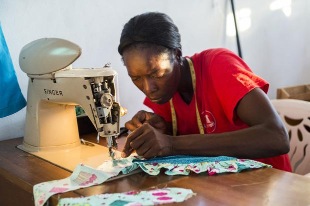 Pocius Menette at the sewing program. 'Before the sewing program I struggled a lot to make money. Now I have skills to help me earn a living. I have also received training in business and how to better manage finances.' Photo: Jennifer Barker